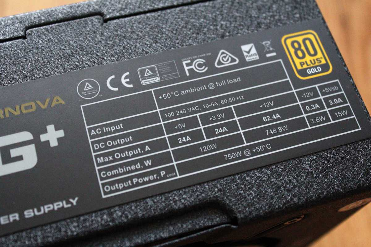 EVGA 750 G+ Power supply specs table on PSU up close